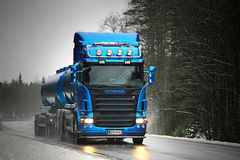 Blue Scania R500 Tank Truck Trucking in Fog and Rain Stock Photography