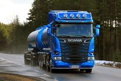 Blue Scania R580 Tank Truck on Wet Asphalt Road at Spring. SALO, FINLAND - MARCH 4, 2017: Blue Scania R580 tank truck for bulk transport of Kuljetusliike Markus Stock Image