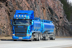 Blue Scania Tank Truck with Rock Face Background Stock Photo
