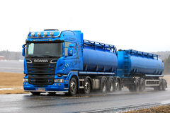 Blue Scania Tank Truck Trucking in Sleet and Rain. SALO, FINLAND - MARCH 4, 2017: Blue Scania R580 tank truck for bulk transport pushes ahead on highway in Royalty Free Stock Images