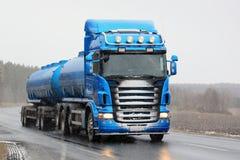 Blue Scania Tank Truck Trucking in Snowfall Royalty Free Stock Photo