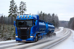 Blue Scania Tank Truck on Winter Road. SALO, FINLAND - JANUARY 14, 2017: Blue Scania R580 delivers precipitated calcium carbonate along rural highway in winter Royalty Free Stock Images