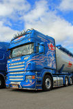 Blue Scania Truck, Detail with Blue Sky and Clouds Stock Photo