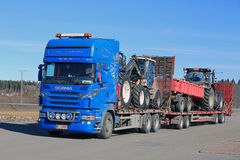 Blue Scania Truck Hauls Agricultural Equipment Stock Photography