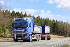 Blue Scania Truck For Limestone Haul on the Road royalty free stock image