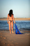Blue scarf. Woman walking at the beach with blue scarf Royalty Free Stock Image
