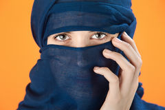 Blue scarf covered woman Royalty Free Stock Image