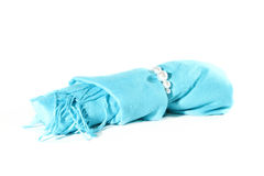 Blue scarf roll with beads Royalty Free Stock Photos