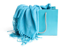 Blue scarf in shopping bag. Against white background Stock Photos