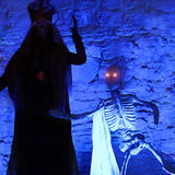 Blue sceleton. Halloween monster with skeleton glowing red eyes in blue darkness stock photos