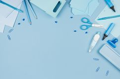 Blue school stationery top view as decorative border on soft pastel background, top view, horizontal. Blue school stationery top view as decorative border on stock image