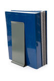 Blue school textbook and bookend Stock Image