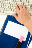 Blue school textbook and computer keyboard. Online learning Stock Photography