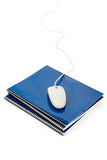 Blue school textbook and computer mouse Royalty Free Stock Images