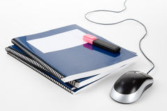 Blue school textbook and computer mouse. Online learning Stock Photo