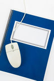 Blue school textbook and computer mouse. Online learning Stock Photography
