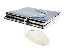 Blue school textbook and computer mouse Royalty Free Stock Photography