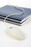 Blue school textbook and computer mouse. Online learning Royalty Free Stock Photos