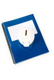 Blue school textbook and piggy bank Stock Image