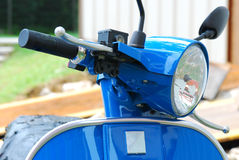 Blue Scooter. A front facing photo taken on a blue painted scooter at a parking lot Royalty Free Stock Images
