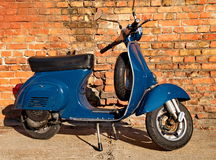 Blue scooter Stock Images