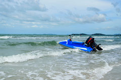 Blue scooter and sea Stock Photos