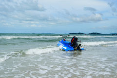 Blue scooter and sea Stock Images