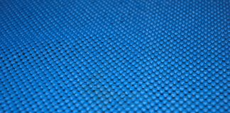 Blue scotch brite cloth texture. With flowers stock image