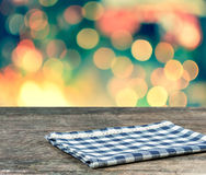 Blue scotch  tablecloth on wood table. Blue scotch  tablecloth on wood table and colour bokeh background Stock Images