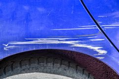Blue scratched car with damaged paint in crash accident on the street or collision on parking lot in the city.  royalty free stock photo
