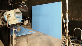 Blue screen backdrop and big LED studio light. For movie video or film photography production and other equipment such as tripod, black screen backdrop, prop stock photo