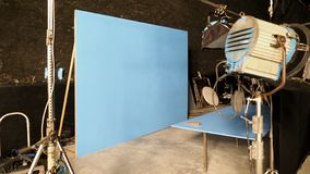 Blue screen backdrop and big LED studio light. For movie video or film photography production and other equipment such as tripod, black screen backdrop, prop stock image