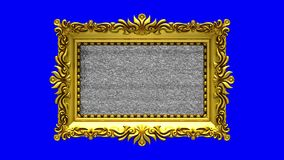 Blue screen on background. Tv noise and green chroma key plays on the screen in ornate gold picture frame. 3D animated. Tv noise on the screen in gold picture stock video footage