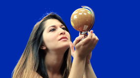Blue screen beautiful girl hold globe sit Stock Photos
