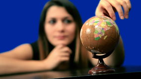 Blue screen beautiful girl hold globe sit table Royalty Free Stock Photos