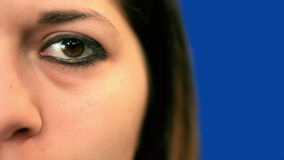 Blue screen beautiful girl left eye extreme close up Royalty Free Stock Images