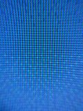 Blue screen closeup. Macro image of blue pixels on a screen stock image