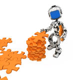 Blue Screen Robot, Jigsaw Pieces. Small 3d robotic figure gathering jigsaw pieces, over white, isolated Royalty Free Stock Photo