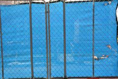 Blue screen with holes at construction site in Portland, Oregon royalty free stock photo