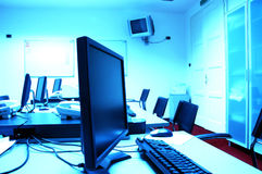 Blue screens in computer room Stock Photo