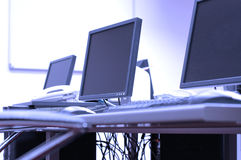 Blue screens in office room Stock Photography