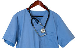 Blue scrubs shirt for medical professional hanging isolated Stock Photography