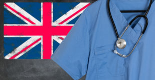 Blue scrubs with UK British flag for immigrant healthcare Royalty Free Stock Photos