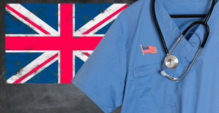 Blue scrubs with UK British flag for immigrant healthcare Stock Photography