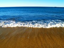 Blue sea. And golden sand Stock Photo