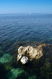Blue sea. Wideangle shot, porous rock in the foreground Stock Images