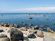 Blue sea. With some rocks in the foreground Stock Image