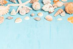 Blue sea background with copy space and seashell border, summer holiday and vacation concept royalty free stock image