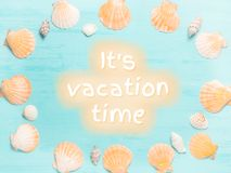 Blue sea background with seashell border and text It`s Vacation Time, summer holidays and vacation time concept.  stock image
