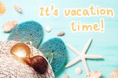 Blue sea background with seashell border and text It`s Vacation Time, summer holidays and vacation time concept.  royalty free stock images